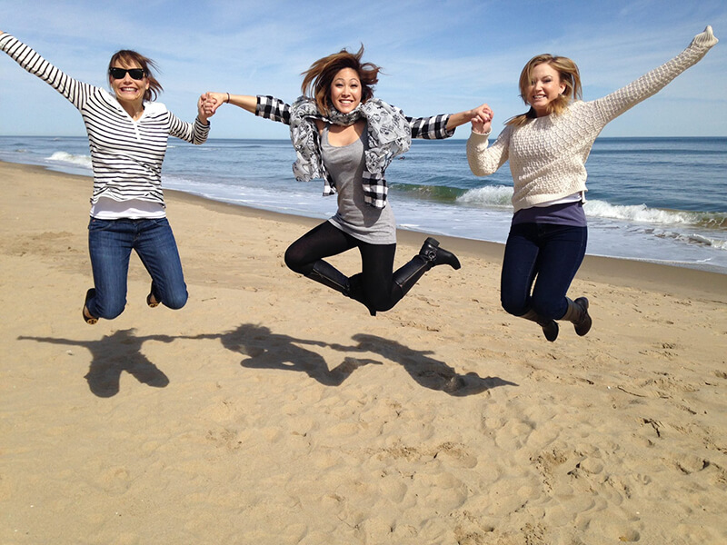 Three of our staff jumping