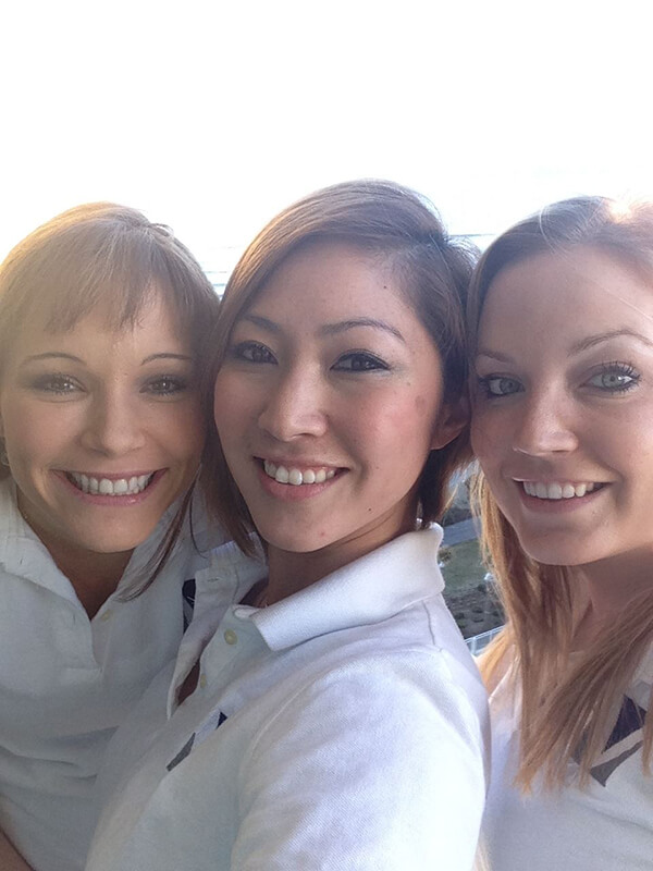 Three of our staff smiling and posing