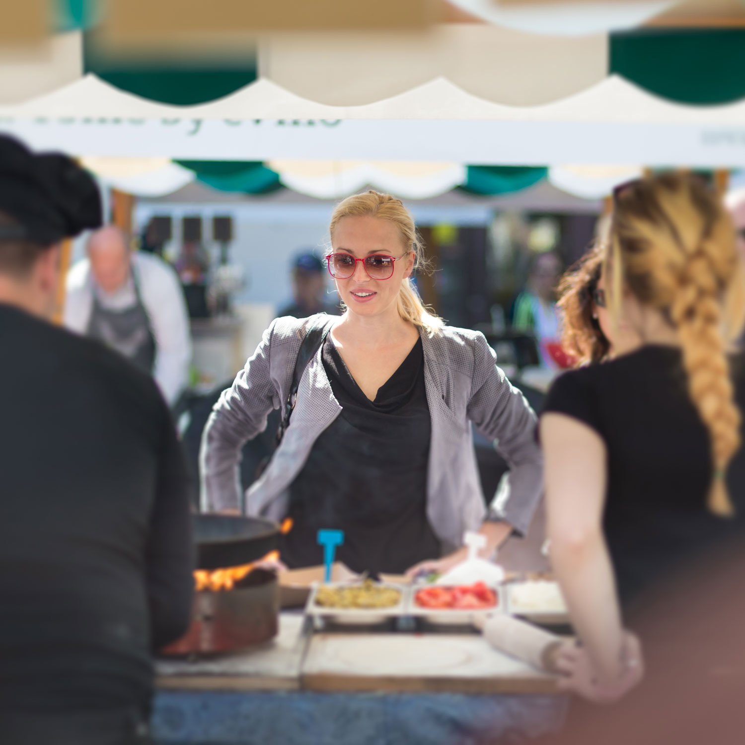 A woman at a booth choosing food