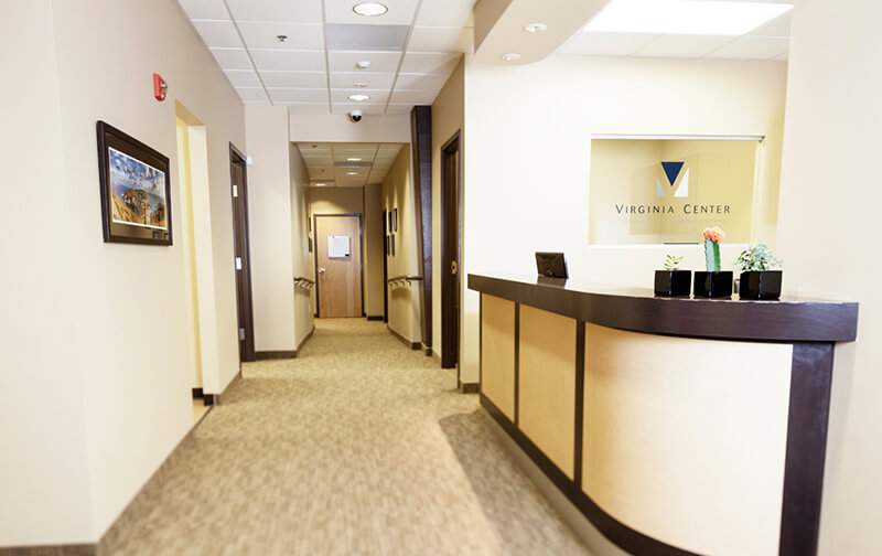 The front desk and hallway leading to the rooms where procedures take place