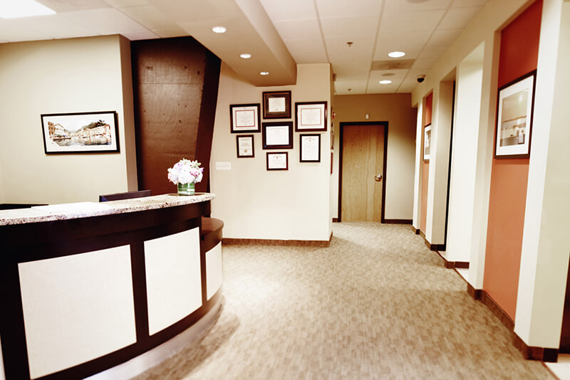 Front desk and hallway leading to the dental suites.